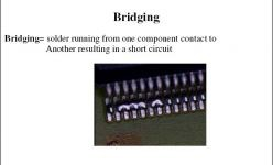 Bridging=solder running from one component contact to another resulting in a short circuit